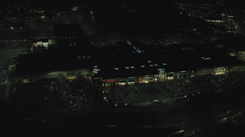 6K stock footage aerial video orbiting around Washington Square shopping mall at nighttime in Tigard, Oregon Aerial Stock Footage AX155_459 | Axiom Images