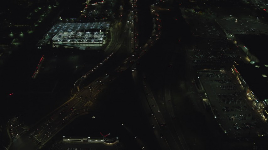 6K stock footage aerial video of and tilt to the interchange of Highways 210 and 217 at night, Beaverton, Oregon Aerial Stock Footage | AX155_460