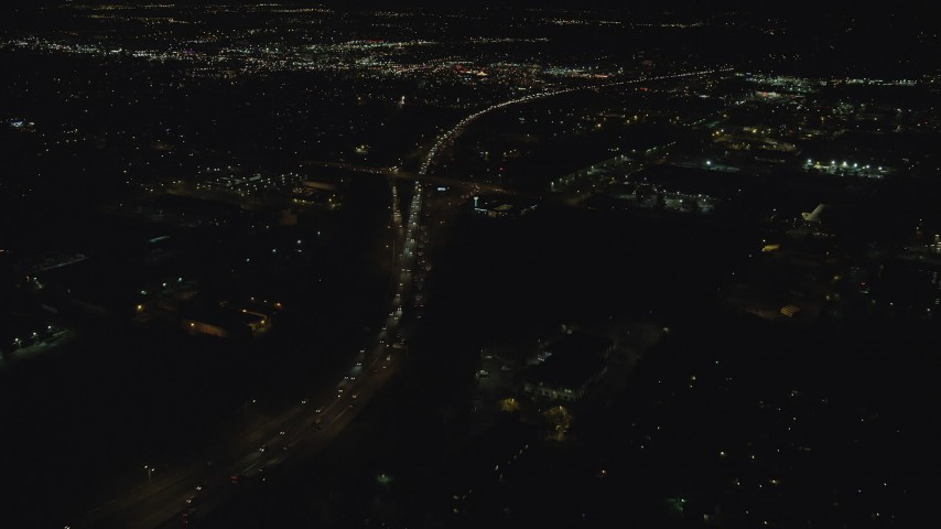 6K stock footage aerial video following light traffic on Highway 217 to approach warehouse buildings at night, Beaverton, Oregon Aerial Stock Footage | AX155_463