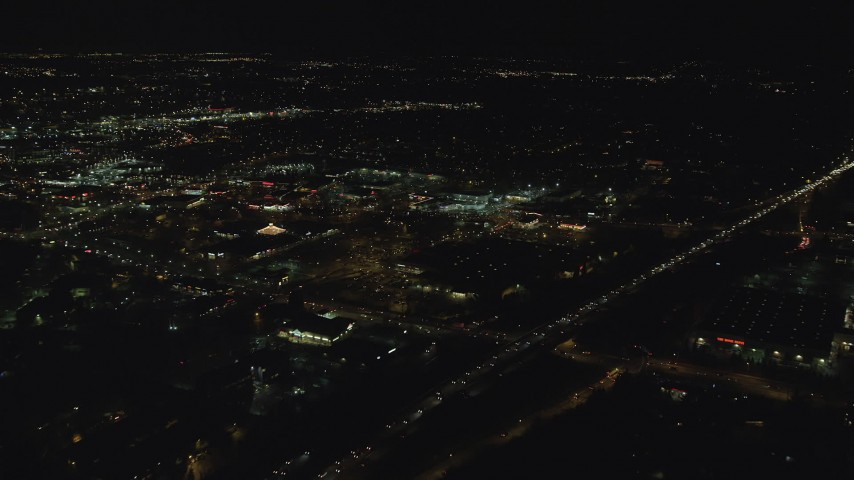6K stock footage aerial video approaching and flying over Beaverton Town Square at night, Beaverton, Oregon Aerial Stock Footage | AX155_465