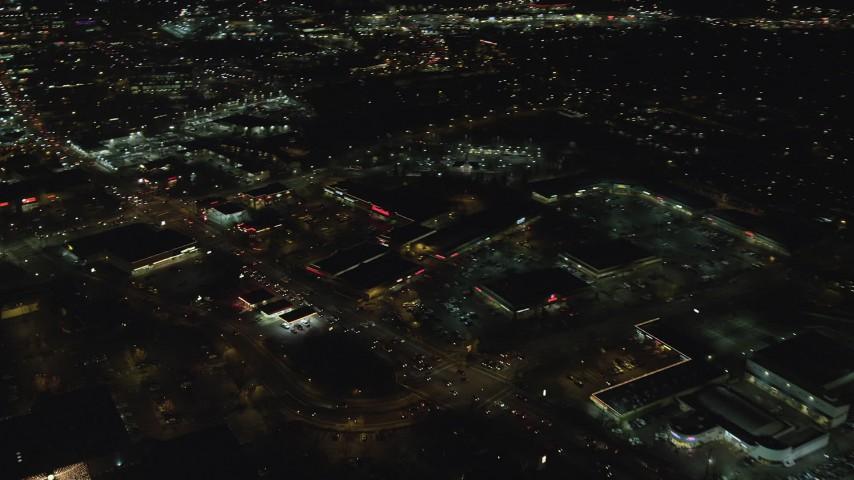 6K stock footage aerial video flying by Beaverton Town Square and SW Canyon Road at night, Beaverton, Oregon Aerial Stock Footage | AX155_466