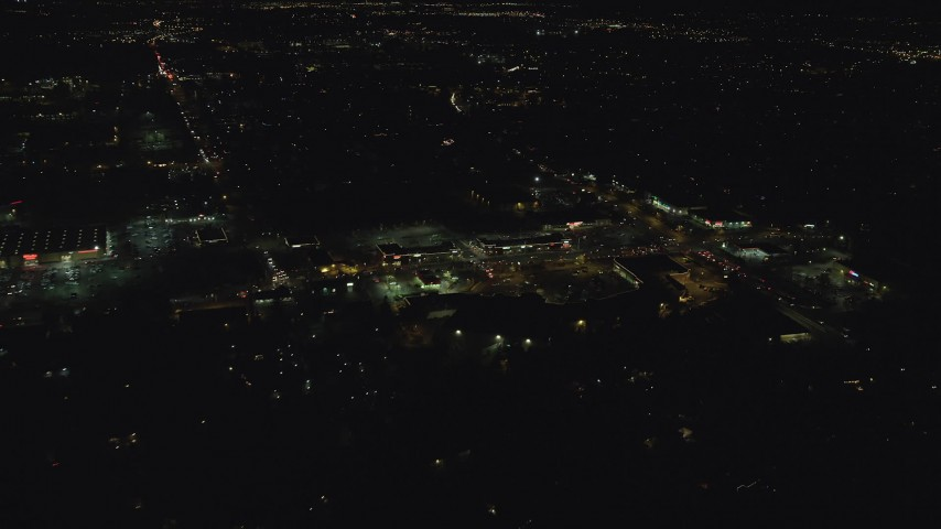 6K aerial video approaching and tilt to stores on SW Cedar Hills Boulevard at night, Beaverton, Oregon Aerial Stock Footage | AX155_467