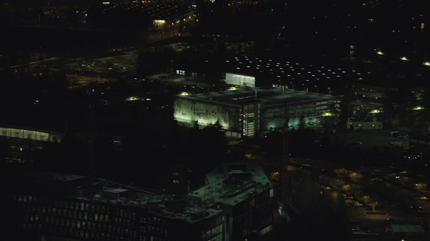 6K aerial video flying by a six-story parking garage at night, Beaverton, Oregon Aerial Stock Footage | AX155_468