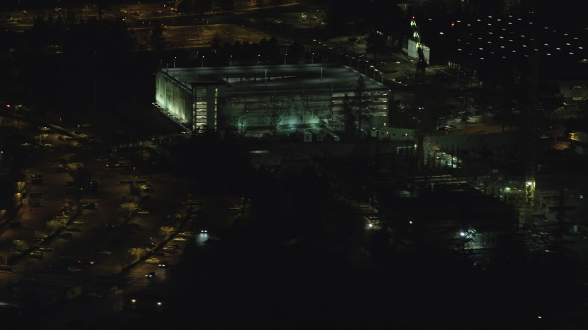 6K aerial video flying by six-story parking garage at night, Beaverton, Oregon Aerial Stock Footage | AX155_469
