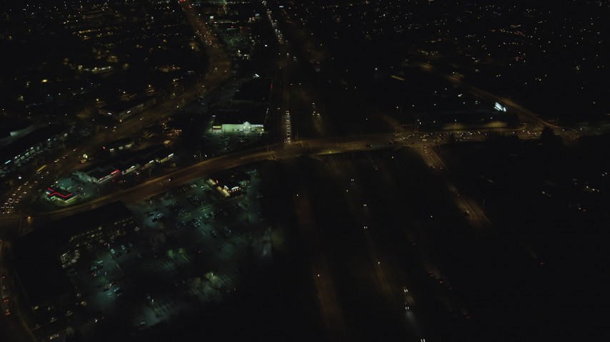 6K stock footage aerial video following light traffic on Highway 26 at night, Beaverton, Oregon Aerial Stock Footage | AX155_470