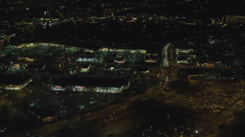 6K stock footage aerial video flying by a busy strip mall at night in Hillsboro, Oregon Aerial Stock Footage | AX155_472