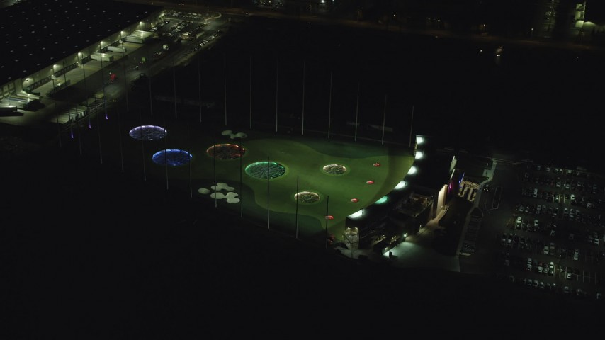 6K aerial video orbiting a Topgolf course in Hillsboro, Oregon at night Aerial Stock Footage | AX155_477