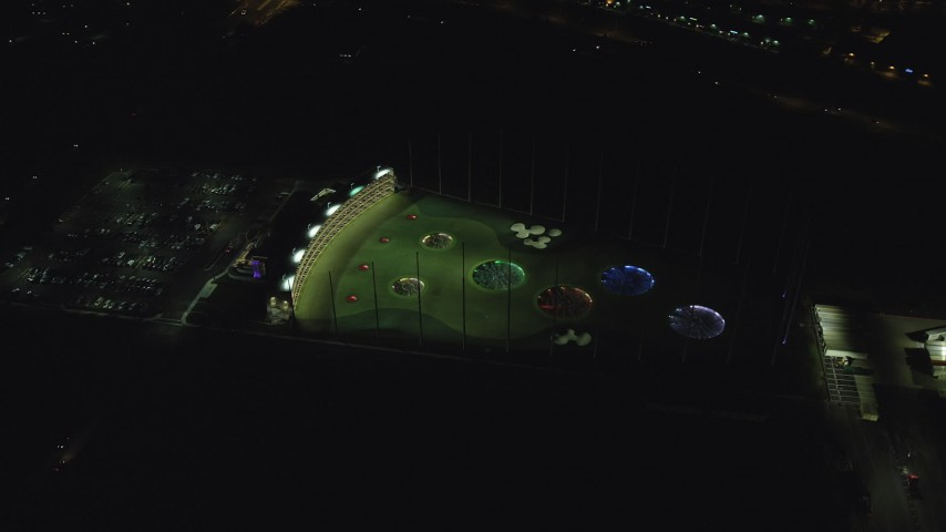 6K stock footage aerial video orbiting the Topgolf course in Hillsboro, Oregon at night Aerial Stock Footage   AX155_480