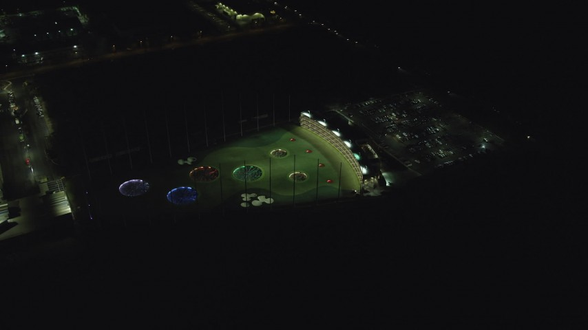6K stock footage aerial video orbiting around the Topgolf course in Hillsboro, Oregon at night Aerial Stock Footage | AX155_482