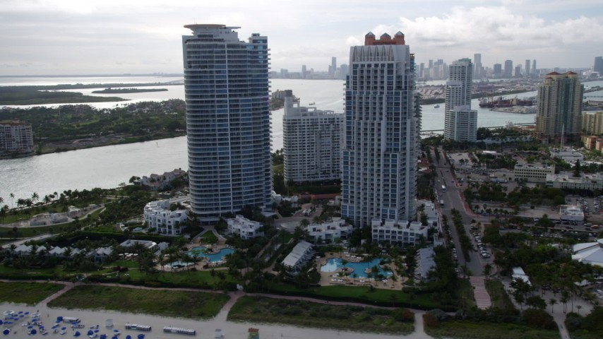 Two Modern Skyscrapers near the Ocean in South Beach, Florida Aerial Stock Footage | AX21_060