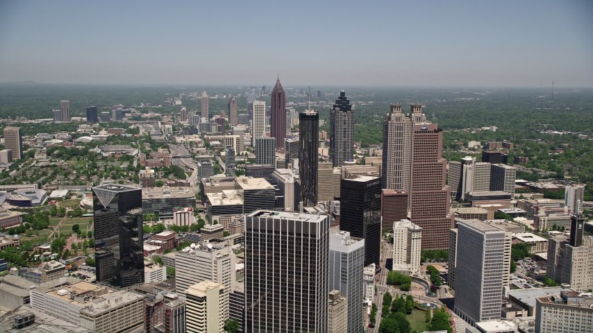 5K stock footage aerial video flying over office buildings near skyscrapers, Downtown Atlanta, Georgia Aerial Stock Footage   AX36_004E