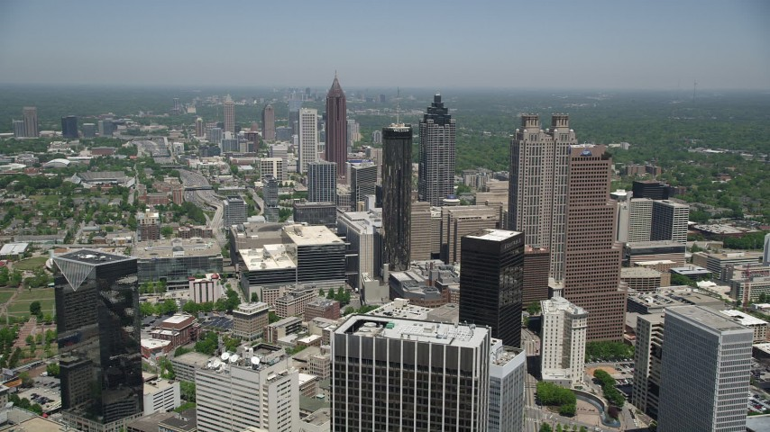 5K aerial video flying over Downtown Atlanta skyscrapers and office buildings, Georgia Aerial Stock Footage | AX36_005