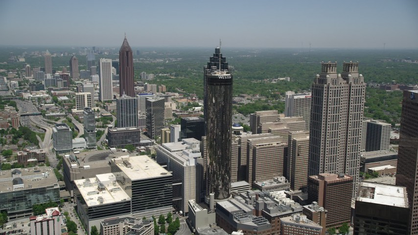 5K aerial video flying over office buildings near skyscrapers, Downtown Atlanta, Georgia Aerial Stock Footage | AX36_006