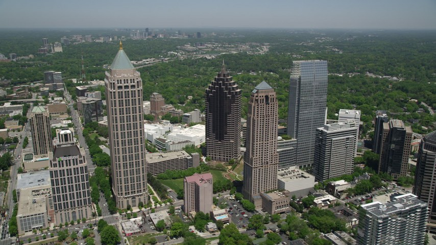 5K stock footage aerial video flying by Midtown Atlanta skyscrapers, Georgia Aerial Stock Footage | AX36_012