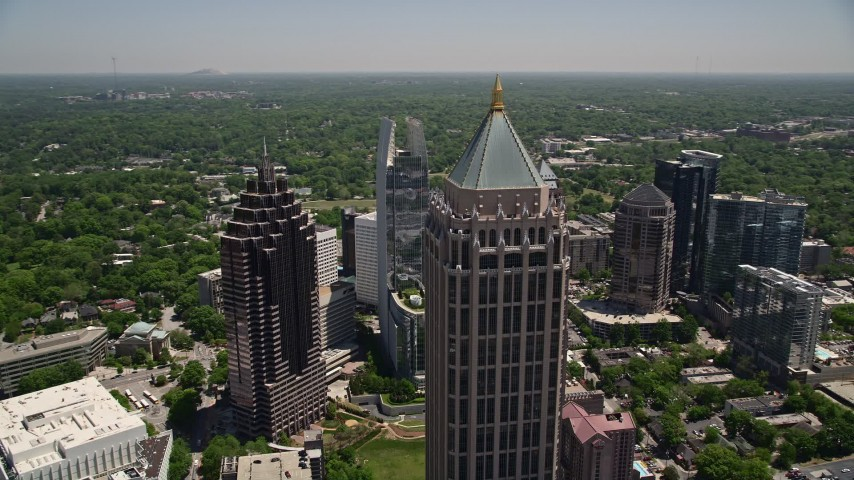 5K aerial video flying by skyscrapers, Midtown Atlanta, Georgia Aerial Stock Footage | AX36_013