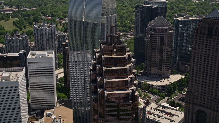 5K aerial video flying by Promenade II, revealing 1180 Peachtree, Midtown Atlanta Aerial Stock Footage | AX36_014