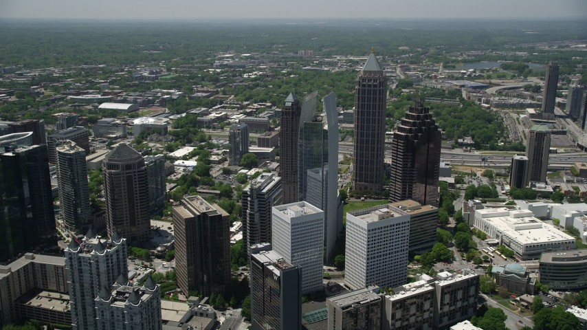5K stock footage aerial video flying by skyscrapers revealing GLG Grand, Midtown Atlanta Aerial Stock Footage | AX36_015