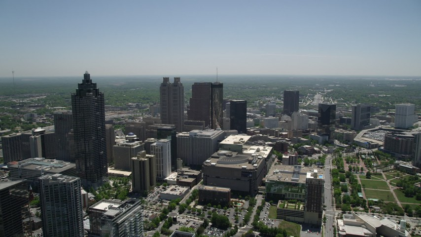 5K stock footage aerial video flying over high-rises and office buildings toward skyscrapers, Downtown Atlanta Aerial Stock Footage | AX36_022