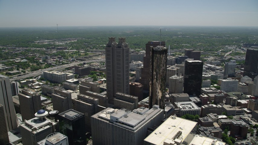 5K aerial video approaching skyscrapers and Westin Hotel, Downtown Atlanta, Georgia Aerial Stock Footage | AX36_023