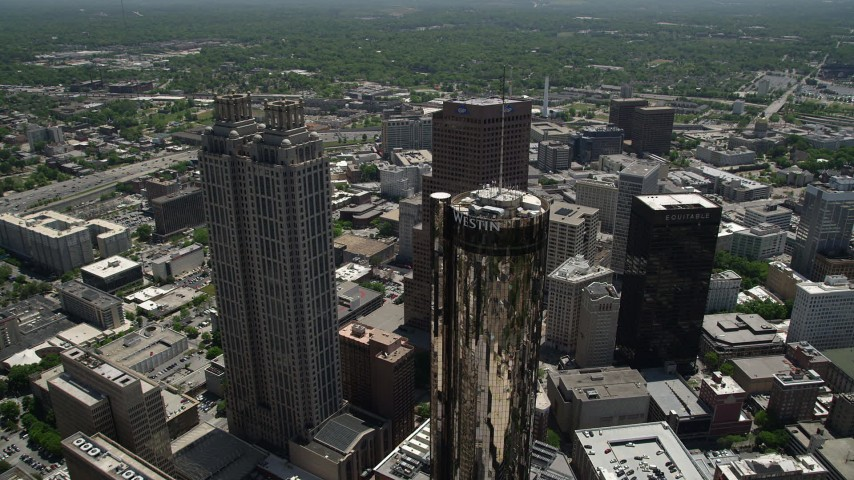 5K aerial video flying over skyscrapers revealing high-rise and office buildings, Downtown Atlanta Aerial Stock Footage | AX36_024