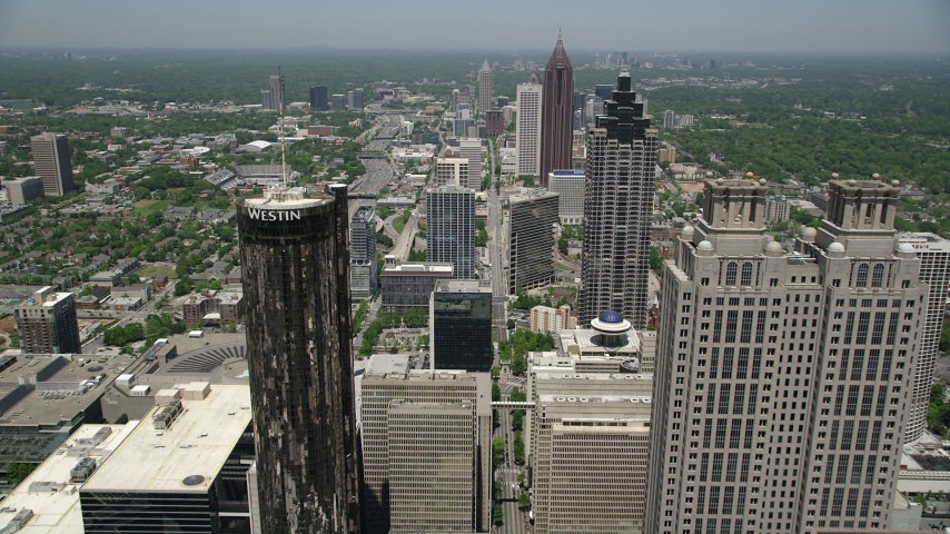 5K aerial video flying over skyscrapers and office buildings, Downtown Atlanta, Georgia Aerial Stock Footage | AX36_039