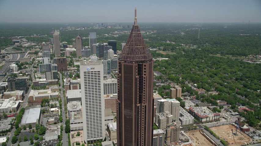 5K aerial video of close-up orbiting the top of Bank of America Plaza and tilt down, Midtown Atlanta Aerial Stock Footage | AX36_042