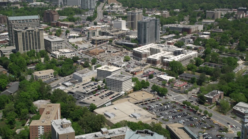 5K aerial video tilting up from skyscrapers to reveal high-rises and skyscrapers, Buckhead, Georgia Aerial Stock Footage | AX36_054