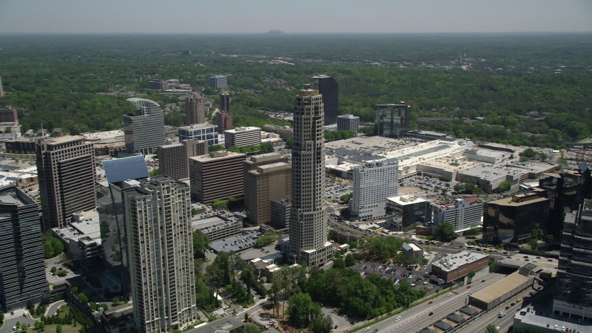 5K stock footage aerial video flying by The Mansion, revealing 3344 Peachtree, Buckhead, Georgia Aerial Stock Footage | AX36_060