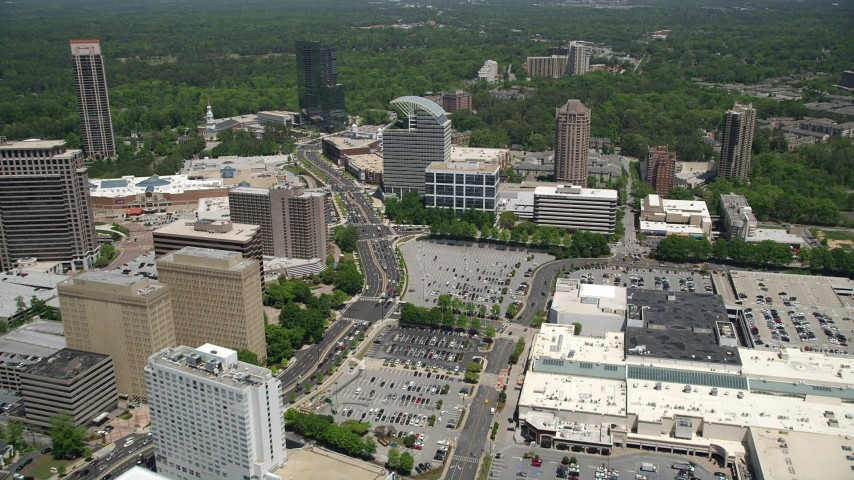 5K stock footage aerial video following Peachtree Road approaching The Pinnacle, Buckhead, Georgia Aerial Stock Footage | AX36_070