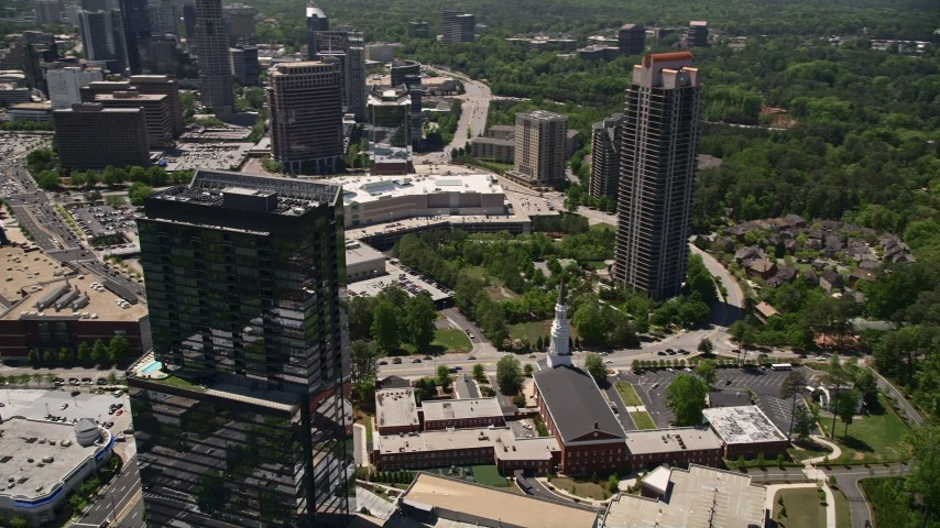 5K stock footage aerial video orbiting 3630 Peachtree Road, revealing a baptist church and shopping center, Buckhead, Georgia Aerial Stock Footage | AX36_072