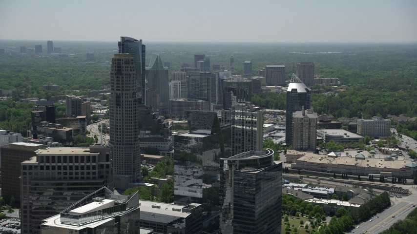 5K stock footage aerial video flying by skyscrapers and high-rises, Buckhead, Georgia Aerial Stock Footage | AX36_074