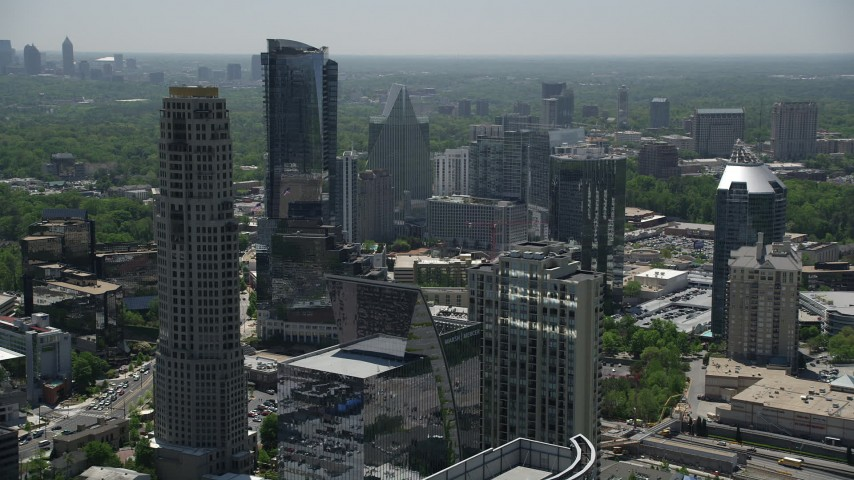 5K stock footage aerial video flying by skyscrapers while approaching Marsh Mercer Building, Buckhead, Georgia Aerial Stock Footage | AX36_075