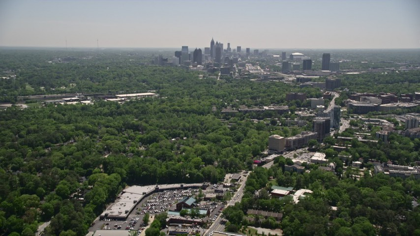 5K stock footage aerial video tilting up from Peachtree Road to reveal Midtown Atlanta skyscrapers, Georgia Aerial Stock Footage | AX36_081