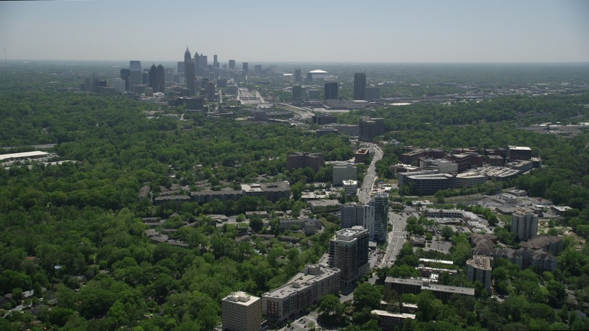 5K stock footage aerial video flying over office buildings toward Midtown Atlanta skyline; Buckhead, Georgia Aerial Stock Footage | AX36_082