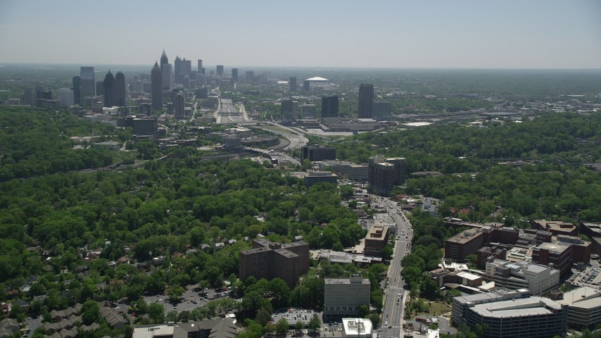5K stock footage aerial video following Peachtree Road toward Midtown Atlanta skyline, Georgia Aerial Stock Footage | AX36_083