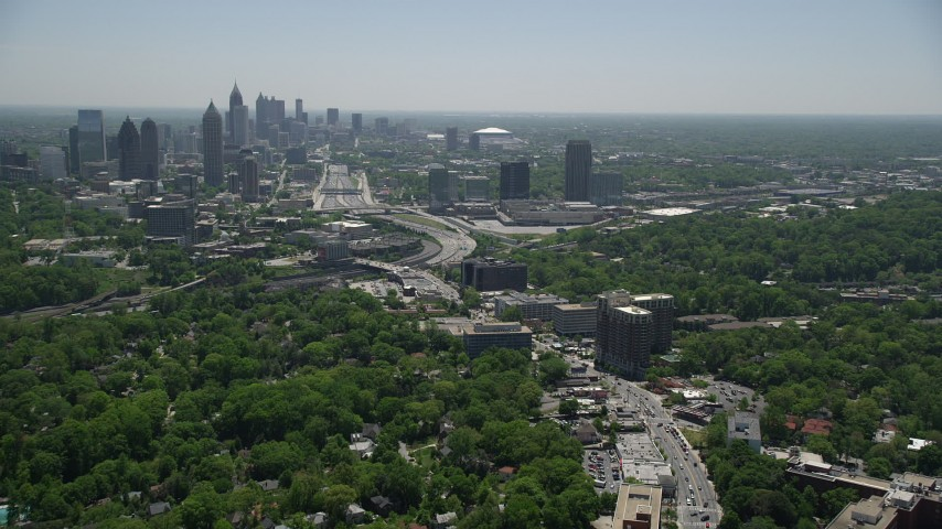 5K aerial video following Peachtree Road toward Midtown Atlanta skyline; Georgia Aerial Stock Footage | AX36_084