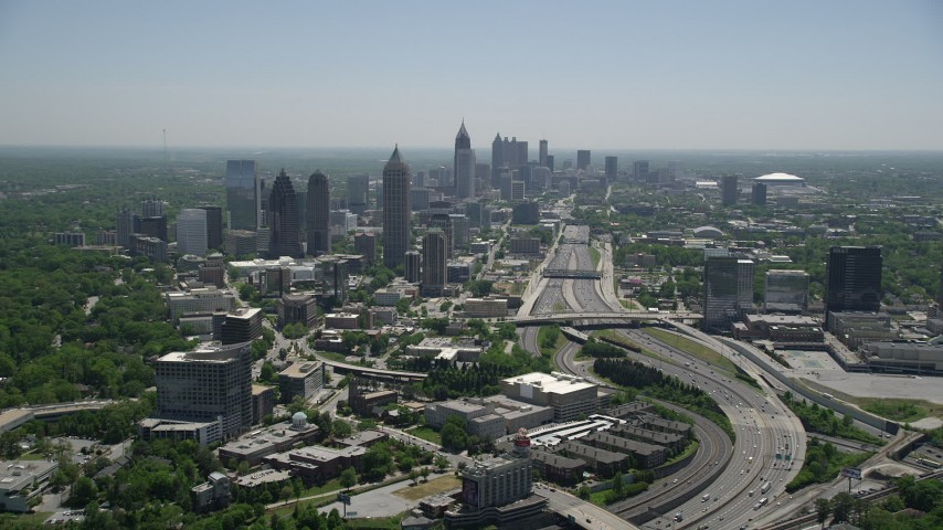 5K stock footage aerial video following Downtown Connector toward Midtown Atlanta skyscrapers, Georgia Aerial Stock Footage | AX36_085