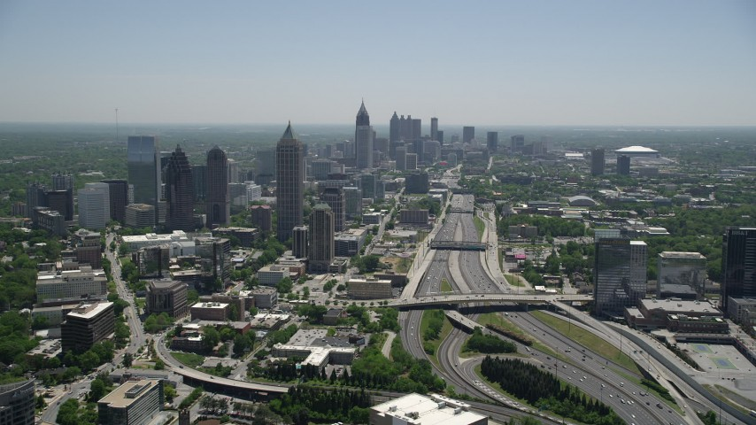 5K stock footage aerial video following Downtown Connector toward Midtown Atlanta skyscrapers, Georgia Aerial Stock Footage | AX36_086