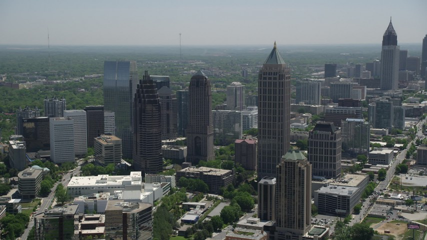 5K aerial video approaching Midtown Atlanta skyscrapers, Georgia Aerial Stock Footage | AX36_087