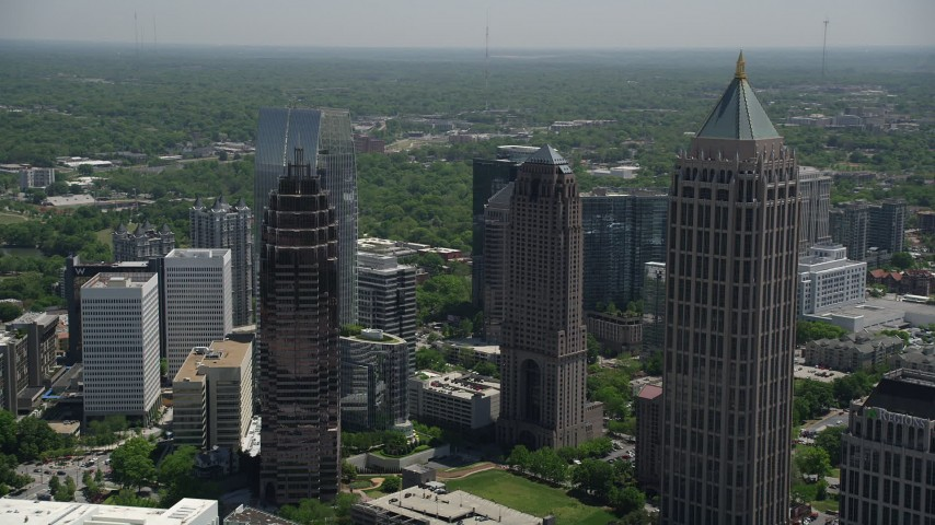 5K stock footage aerial video flying by One Atlantic Center and Midtown Atlanta skyscrapers, Georgia Aerial Stock Footage | AX36_088