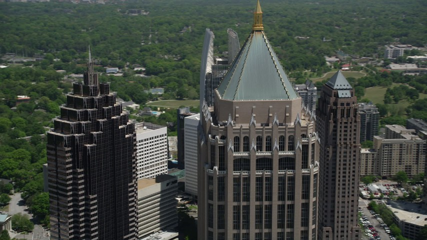 5K stock footage aerial video flying by One Atlantic Center and Midtown Atlanta skyscrapers, Georgia Aerial Stock Footage | AX36_089