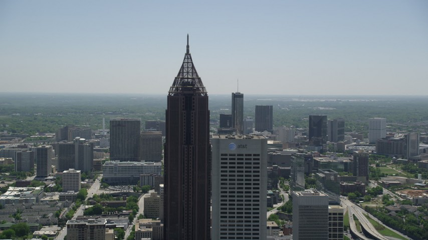 5K stock footage aerial video flying by Bank of America Plaza revealing Midtown Atlanta skyscrapers, Georgia Aerial Stock Footage | AX36_091