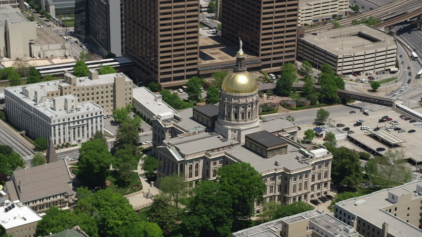 5K aerial video orbiting Georgia State Capitol, Downtown Atlanta Aerial Stock Footage | AX36_097