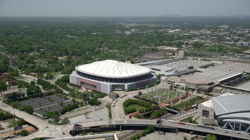 5K stock footage aerial video approaching and tilting down on Georgia Dome, Downtown Atlanta Aerial Stock Footage | AX36_103