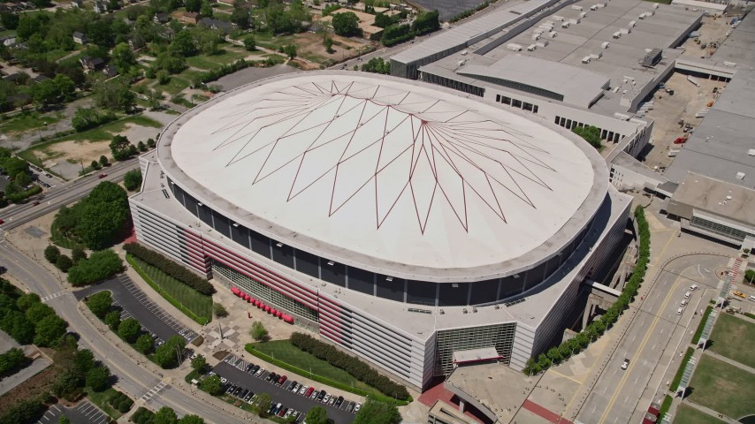 5K stock footage aerial video tilting down on Georgia Dome, Downtown Atlanta Aerial Stock Footage | AX36_104
