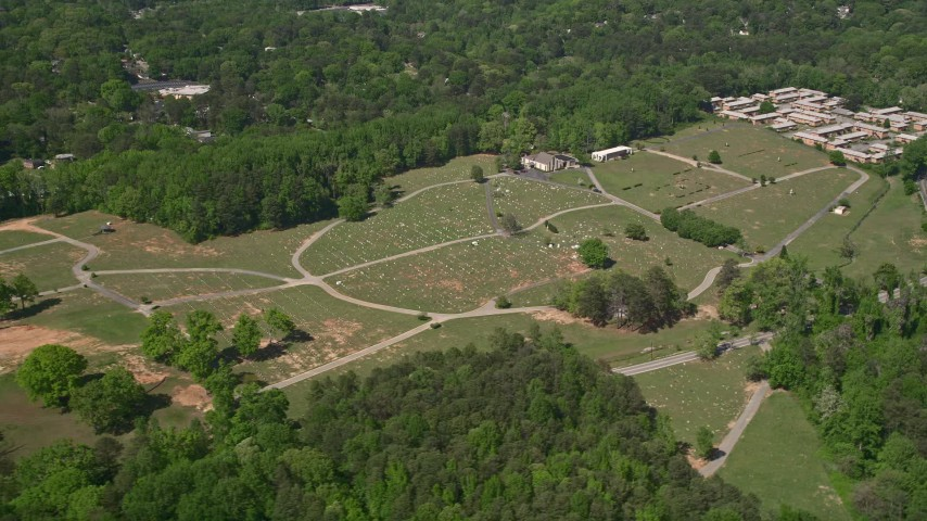 5K stock footage aerial video flying by a cemetary among trees, Atlanta, Georgia Aerial Stock Footage | AX37_002