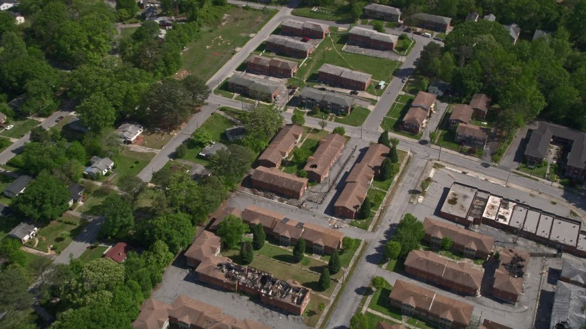 5K stock footage aerial video flying over abandoned residential buildings, West Atlanta Aerial Stock Footage | AX37_003