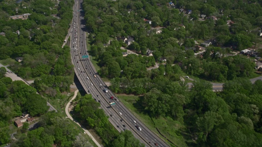 5K stock footage aerial video of light traffic on a freeway tilt up revealing residential area, West Atlanta Aerial Stock Footage | AX37_007