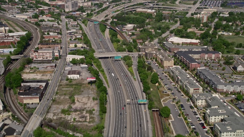 5K stock footage aerial video following freeway revealing Downtown Atlanta, Georgia Aerial Stock Footage | AX37_010