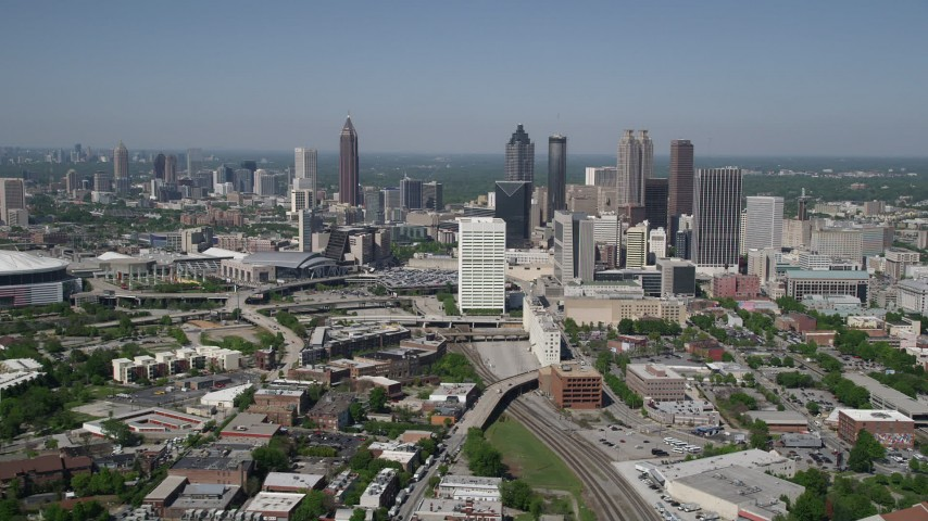 5K stock footage aerial video approaching Midtown skyscrapers with Downtown Atlanta in the distance, Georgia Aerial Stock Footage | AX37_011